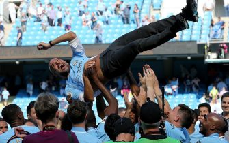 epa06715316 Manchester City's manager Pep Guardiola is thrown in the air by players as they celebrate the Premier League title following the English Premier League soccer match between Manchester City and Huddersfield Town at the Etihad Stadium in Manchester, Britain, 06 May 2018.  EPA/NIGEL RODDIS EDITORIAL USE ONLY. No use with unauthorised audio, video, data, fixture lists, club/league logos 'live' services. Online in-match use limited to 75 images, no video emulation. No use in betting, games or single club/league/player publications.