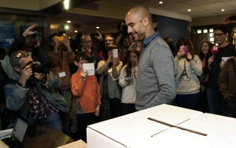 Catalan Pep Guardiola, coach of German Bayern Munich, smiles after casting his vote for the non binding 'referendum' for independence in Barcelona, Catalonia, Spain, 09 November 2014. The non binding 'referendum' on Catalonia's independence from Spain is taking place despite a ruling by Spanish Constitutional Court that it would be illegal. EFE/Toni Albir