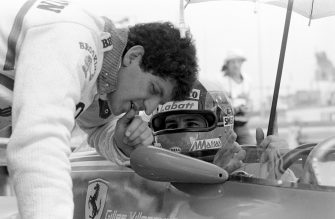 Jody Scheckter leans over his Ferrari team mate Gilles Villeneuve to discuss the set-up during a practice session for the South African Grand Prix at Kyalami, 3rd March 1979. Villeneuve won and Scheckter came home second. (Photo by Klemantaski Collection/Getty Images)
