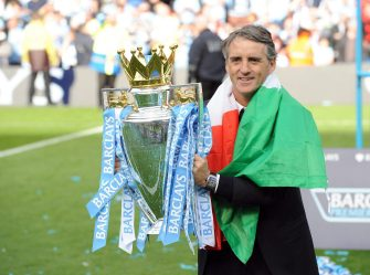 Manchester City manager Roberto Mancini celebrates winning the League with the Premier League trophy after the English Premier League soccer match at Etihad Stadium Manchester, Britain, 13 May 2012.  ANSA/PETER POWELL
