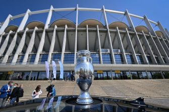 The Coupe Henri Delaunay, the trophy of the UEFA European Football Championship is pictured in front of the National Arena stadium, the venue to host four football matches, during the presentation tour of the trophy in Bucharest, April 25, 2021. - Held over from 2020 due to the pandemic, the European Championship will now be held in 11 different countries from June 11-July 11, 2021. (Photo by Daniel MIHAILESCU / AFP) (Photo by DANIEL MIHAILESCU/AFP via Getty Images)