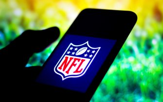 In this photo illustration the NFL (National Football League) logo seen displayed on a smartphone.