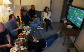Group of people watch NFL Superbowl XLVIII on television, Feb. 2, 2014, Denver Broncos vs. Seattle Seahwaks