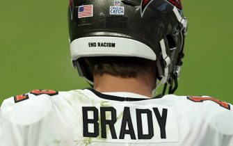 """Oct 25, 2020; Paradise, Nevada, USA; Tampa Bay Buccaneers quarterback Tom Brady (12) wears Crucial Catch breast cancer awareness sticker and """"End Racism"""" on his helmet against the Las Vegas Raiders at Allegiant Stadium. The Buccaneers defeated the Raiders 45-20. Mandatory Credit: Kirby Lee-USA TODAY Sports/Sipa USA"""