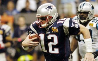 epa00127561 New England Patriots quarterback Tom Brady scrambles for a first down inside the 10 yard line setting up a first and goal in the second quarter of Super Bowl XXXVIII in Houston, Texas Sunday 01 February 2004.  EPA/RHONA WISE