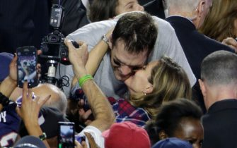 Tom Brady is kissed by his wife Gisele Bundchen after winning Super Bowl 49 on February 1, 2015 in Glendale, Arizona. Photo by Francis Specker