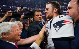 New England Patriots Quarterback Tom Brady #12 hugs Patriots owner Robert Kraft during the post-game of Super Bowl LIII at Mercedes-Benz Stadium in Atlanta, Georgia on Feb. 3, 2019. The New England Patriots defeated the LA Rams 13-3. (Photo by Anthony Behar/Sipa USA)
