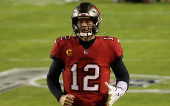 Jan 9, 2021; Landover, Maryland, USA; Tampa Bay Buccaneers quarterback Tom Brady (12) jogs onto the field prior to the Buccaneers' game against the Washington Football Team at FedExField. Mandatory Credit: Geoff Burke-USA TODAY Sports/Sipa USA