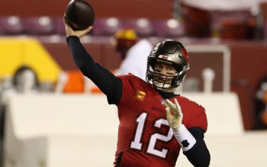 Jan 9, 2021; Landover, Maryland, USA; Tampa Bay Buccaneers quarterback Tom Brady (12) passes the ball during warmups prior to the Buccaneers' game against the Washington Football Team at FedExField. Mandatory Credit: Geoff Burke-USA TODAY Sports/Sipa USA