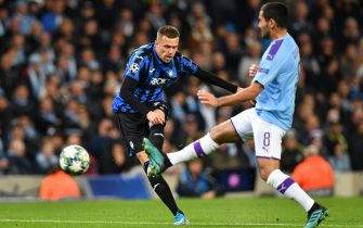 Atalanta's Slovenian midfielder Josip Ilicic (L) has a shot but doesn't score during the UEFA Champions League Group C football match between Manchester City and Atalanta at the Etihad Stadium in Manchester, northwest England on October 22, 2019. (Photo by Paul ELLIS / AFP) (Photo by PAUL ELLIS/AFP via Getty Images)