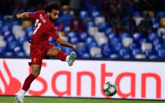 Liverpool's Egyptian midfielder Mohamed Salah shoots on goal during the UEFA Champions League Group E football match Napoli vs Liverpool on September 17, 2019 at the San Paolo stadium in Naples. (Photo by Alberto PIZZOLI / AFP)        (Photo credit should read ALBERTO PIZZOLI/AFP via Getty Images)