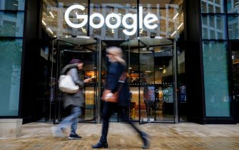 People walk past Google's UK headquarters in London on November 1, 2018. - Hundreds of employees walked out of Google's European headquarters in Dublin on Thursday as part of a global campaign over the US tech giant's handling of sexual harassment that saw similar protests in London and Singapore. (Photo by Tolga Akmen / various sources / AFP)        (Photo credit should read TOLGA AKMEN/AFP via Getty Images)