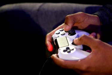 LONDON, ENGLAND - MARCH 28: A detailed view of a PS4 controller as players practice during day one of the 2019 ePremier League Finals at Gfinity Arena on March 28, 2019 in London, England. (Photo by Alex Pantling/Getty Images)