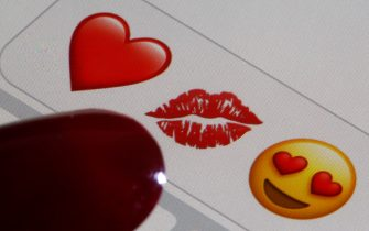PARIS, FRANCE - FEBRUARY 14: In this photo illustration, emoji or emoticon representing a heart, lips and heart-shaped eyes are displayed on the screen of an iPhone on Valentine's Day on February 14, 2020 in Paris, France. Valentine's Day is known as the Lovers' Day and the celebration of love and romance in many parts of the world. (Photo by Chesnot/Getty Images)