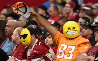 GLENDALE, AZ - SEPTEMBER 18:  Fans wearing emoji masks wave during the second half of the NFL game between the Arizona Cardinals and the Tampa Bay Buccaneers at University of Phoenix Stadium on September 18, 2016 in Glendale, Arizona. The Arizona Cardinals won 40-7. (Photo by Norm Hall/Getty Images)