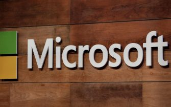 (FILES) In this file photo the Microsoft logo is pictured during the annual Microsoft shareholders meeting in Bellevue, Washington on November 29, 2017. - Microsoft will acquire artificial intelligence and cloud computing company Nuance for $19.7 billion, the company announced on April 12, 2021. Nuance's technology is used extensively in medical records, and the transaction will bolster Microsoft's healthcare offerings, Microsoft said in a news release. The transaction is all-cash and the sum includes Nuance's net debt. (Photo by Jason Redmond / AFP)