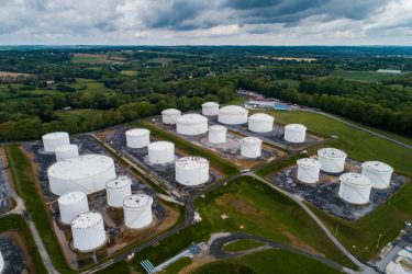 epa09185947 An image made with a drone shows fuel tanks at a Colonial Pipeline breakout station in Woodbine, Maryland, USA, 08 May 2021. A cyberattack forced the shutdown of 5,500 miles of Colonial Pipeline's sprawling interstate system, which carries gasoline and jet fuel from Texas to New York.  EPA/JIM LO SCALZO
