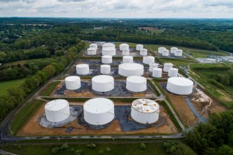 epa09185946 An image made with a drone shows fuel tanks at a Colonial Pipeline breakout station in Woodbine, Maryland, USA, 08 May 2021. A cyberattack forced the shutdown of 5,500 miles of Colonial Pipeline's sprawling interstate system, which carries gasoline and jet fuel from Texas to New York.  EPA/JIM LO SCALZO