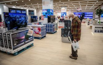 An elderly shopper browses televisions on display inside the AliExpress plaza retail store, operated by Alibaba Group Holding Ltd., in Barcelona, Spain, on Wednesday, Jan. 13, 2020. U.S. officials deliberated but ultimately decided against banning American investment in Alibaba and Tencent Holdings Ltd., a person familiar with the discussions said, removing a cloud of uncertainty over Asia's two biggest corporations. Photographer: Angel Garcia/Bloomberg