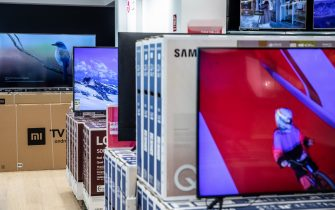 Smart televisions on display inside the AliExpress plaza retail store, operated by Alibaba Group Holding Ltd., in Barcelona, Spain, on Wednesday, Jan. 13, 2020. U.S. officials deliberated but ultimately decided against banning American investment in Alibaba and Tencent Holdings Ltd., a person familiar with the discussions said, removing a cloud of uncertainty over Asia's two biggest corporations. Photographer: Angel Garcia/Bloomberg