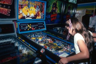 A young girl is photographed June 1, 1982 playing Pac-Man at a video arcade in Times Square, New York City. (Photo by Yvonne Hemsey/Getty Images)