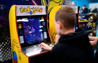"A boy plays the ""Pacman"" retro game at the Video games trade fair Gamescom in Cologne, western Germany, on August 21, 2019. (Photo by Ina FASSBENDER / AFP)        (Photo credit should read INA FASSBENDER/AFP via Getty Images)"