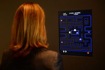 The Museum of Modern Art (MoMA) Senior Curator of Architecture and Design Paola Antonelli plays the video game Pac-Man during a preview of the MoMa's exhibition featuring 14 acquired video games in New York, March 1, 2013. MoMA acquired 14 video games entering its collection as part of an ongoing research on interaction design. AFP PHOTO/EMMANUEL DUNAND        (Photo credit should read EMMANUEL DUNAND/AFP via Getty Images)