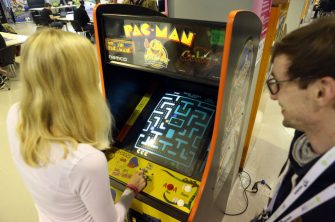 BERLIN, GERMANY - APRIL 26:  Visitor Alina Ullrich plays a vintage Pac-Man video game at the Making Games conference during International Games Week on April 26, 2017 in Berlin, Germany. The event is intended to showcase independant video game design in a city known for its technology and Internet-related startups.  (Photo by Adam Berry/Getty Images)