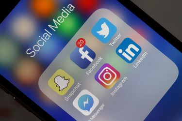 PARIS, FRANCE - MAY 12:  In this photo illustration, logos of the Snapchat, Facebook, Twitter, Messenger, Instagram and LinkedIn applications are displayed on the screen of an Apple iPhone on May 12, 2018 in Paris, France. Faced with the anger of dissatisfied users, the Snapchat application has canceled certain changes, announced at the end of 2017, in the presentation of the application, announced its parent company Snap Friday. Snap, which accumulates the financial losses, announced last November a redesign of this app popular with teenagers to attract new users and advertisers. Snapchat is a free photo and video sharing application available on iOS and Android mobile platforms from Snap Inc. (Photo Illustration by Chesnot/Getty Images)