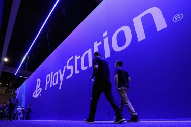 LOS ANGELES, CA - JUNE 13:  Game enthusiasts and industry personnel walk past the 'Sony Playstation' exhibit during the Electronic Entertainment Expo E3 at the Los Angeles Convention Center on June 13, 2017 in Los Angeles, California.  (Photo by Christian Petersen/Getty Images)