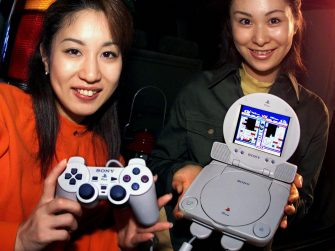 MAKUHARI, JAPAN:  (FILER) Japan's video game giant Sony Computer Entertainment (SCE) campaign girls display the PSone video game console during the annual Tokyo Game Show in Makuhari, suburban Tokyo 14 October 2001.  SCE said 19 May 2004 that global shipments of its series of PlayStation consoles have exceeded 100 million units, a record high for houseold computer games.    AFP PHOTO/Yoshikazu TSUNO  (Photo credit should read YOSHIKAZU TSUNO/AFP via Getty Images)
