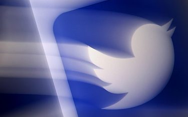 (FILES) In this file photo illustration taken on August 10, 2020 shows a Twitter logo displayed on a mobile phone in Arlington, Virginia. - As US President Joe Biden took office on January 20, 2021, Twitter handed him the reins of an official @POTUS account as part of the transfer of power. The one-to-many messaging service gave Biden's team control of all the official White House accounts, and activated a new @SecondGentleman handle for the husband of the country's first female vice president Kamala Harris. (Photo by Olivier DOULIERY / AFP)