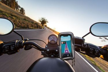 The view over the handlebars of motorcycle. Travel theme.