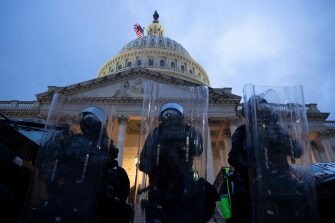 epa08923720 Police stand outside the East Front of the US Capitol at dusk as a curfew begins after pro-Trump protesters stormed the grounds leading to chaos, in Washington, DC, USA, 06 January 2021. Various groups of Trump supporters have broken into the US Capitol and rioted as Congress prepares to meet and certify the results of the 2020 US Presidential election.  EPA/MICHAEL REYNOLDS