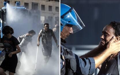 Roma, tensioni tra migranti e polizia durante sgombero: usati idranti