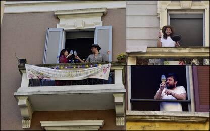 Coronavirus, Pasqua a Milano si festeggia sui balconi. FOTO